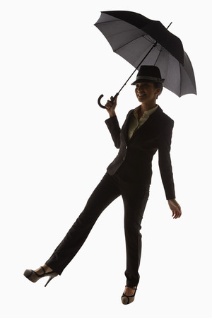 Businesswoman holding an umbrella photo