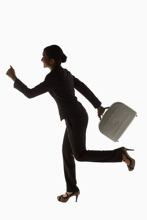 Businesswoman carrying a briefcase, running photo