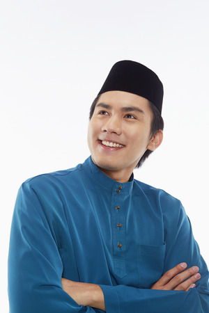 Man in traditional clothing smiling