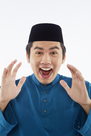 malay ethnicity: Man in traditional clothing looking surprised