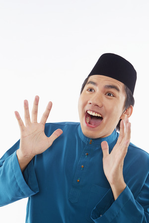 Man in traditional clothing looking surprised