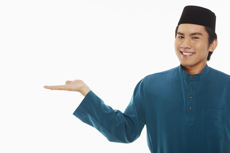 hand gesture: Man in traditional clothing showing hand gesture Stock Photo