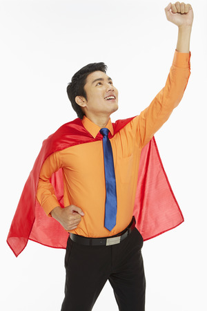 Businessman with a red cape showing hand gesture photo