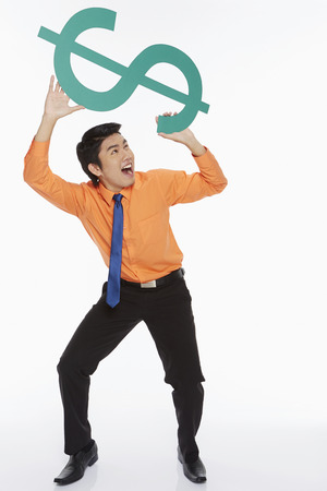 Businessman lifting up a dollar sign photo