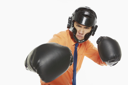Businessman dressed with boxing gear photo