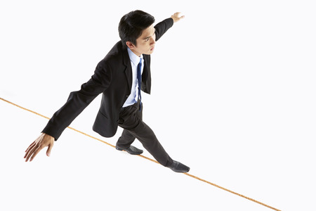 Businessman walking on a rope photo