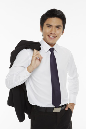 Businessman carrying a jacket over his shoulder photo