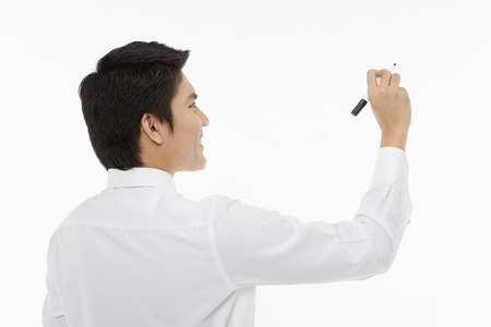 Businessman showing a writing gesture photo