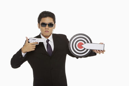 Security staff pointing a gun to a dart board photo