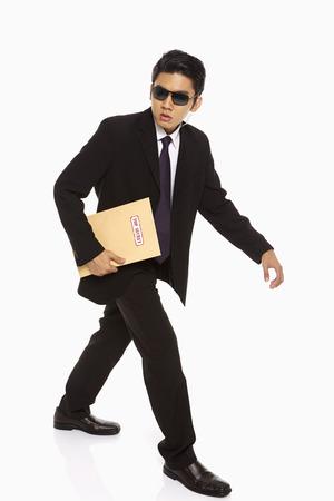 Man holding a Top Secret envelope photo