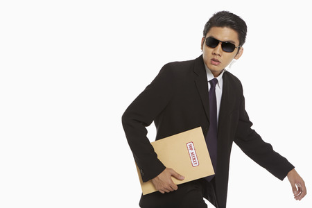 cautious: Man holding a Top Secret envelope Stock Photo