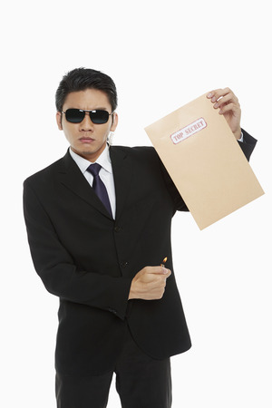 Man holding a Top Secret envelope photo