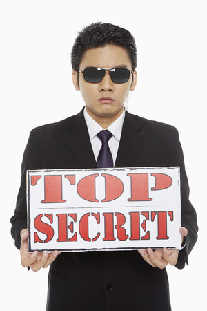 Man holding up a Top Secret sign photo