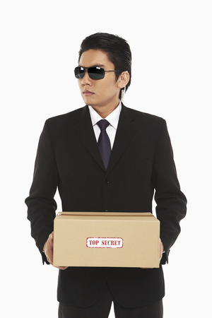Security staff holding a Top Secret package photo