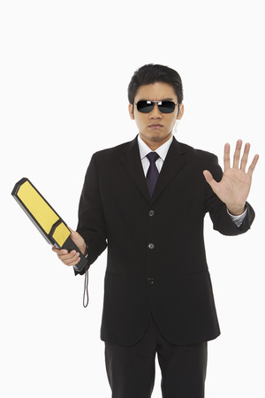 metal detector: Security staff with a metal detector Stock Photo