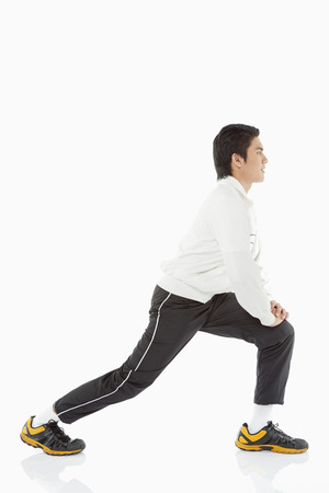 facing right: Man doing lunges, facing right Stock Photo