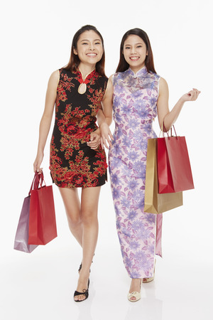 Women carrying shopping bags photo