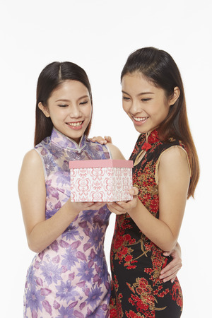 Women holding a gift box photo