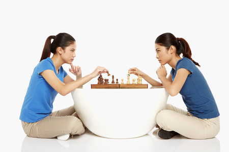 Women playing a game of chess photo