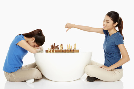 Woman cheering after winning a game of chess Stock Photo - 22838859