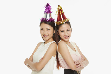 Two cheerful women smiling