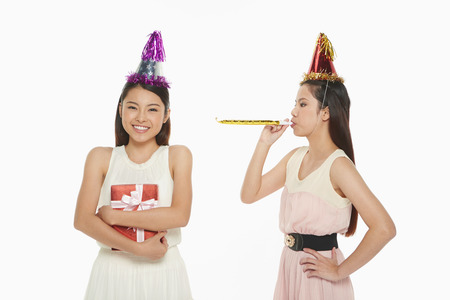 Woman blowing a party horn blower photo