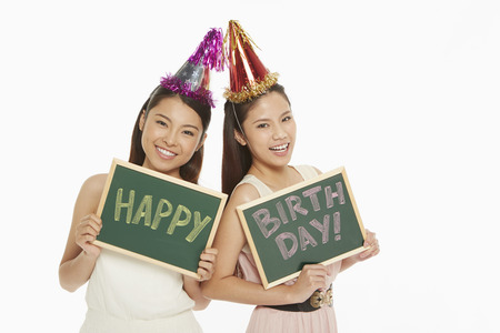 western script: Women holding up a Happy Birthday sign