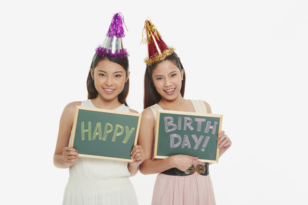 Women holding up a Happy Birthday