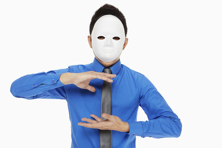 hand gesture: Businessman with mask showing hand gesture Stock Photo