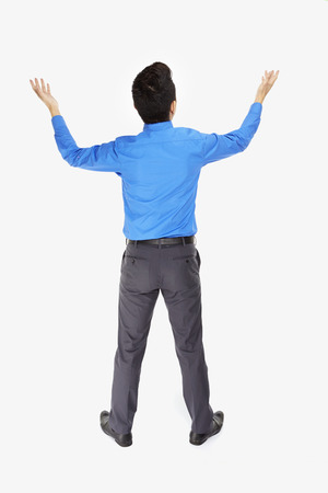 Businessman lifting up his hands photo