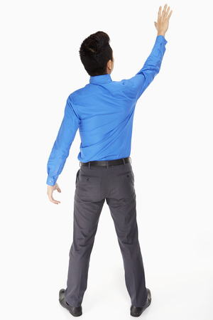 Businessman lifting up his hand photo