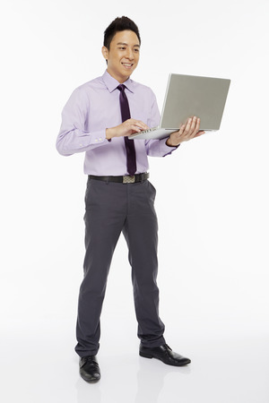 Businessman using laptop photo