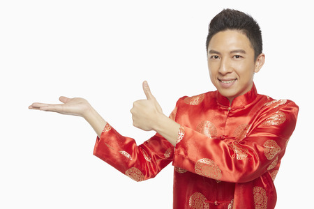 Man in traditional clothing showing hand gesture Banco de Imagens