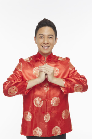 Man in traditional clothing showing hand greeting gesture Stock Photo - 22839230