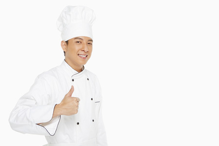 Cheerful chef showing hand gesture
