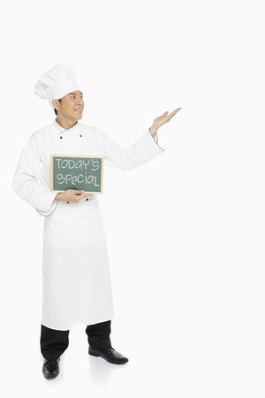 Chef holding up a Todays Special sign photo
