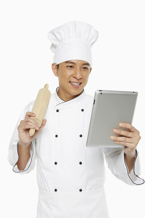 Chef using a digital tablet photo