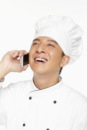 Chef talking on his mobile phone photo