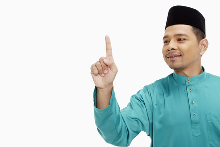 Man in traditional clothing showing hand gesture photo