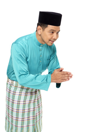 Man in traditional clothing showing hand greeting gesture photo