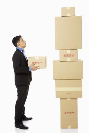 Businessman holding a cardboard box photo