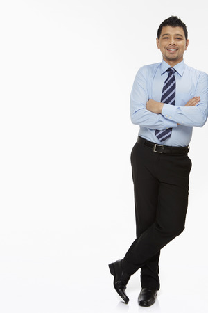 Businessman leaning against a wall photo