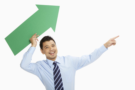 Businessman throwing an arrow upwards photo