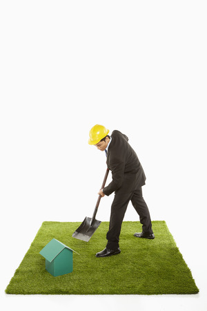 dug well: Businessman using a shovel