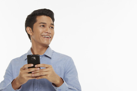 Man text messaging with mobile phone