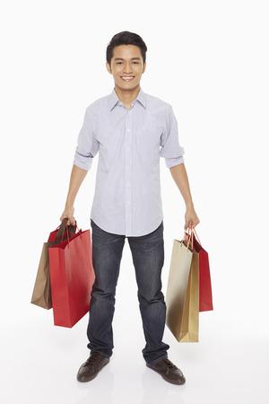 Man carrying shopping bags Stock Photo