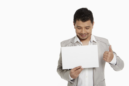 Man holding up a blank placard photo