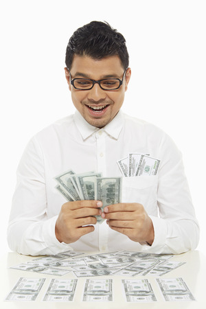 Man holding a pile of cash photo