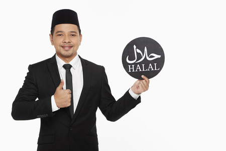 Businessman holding up a Halal' sign' photo