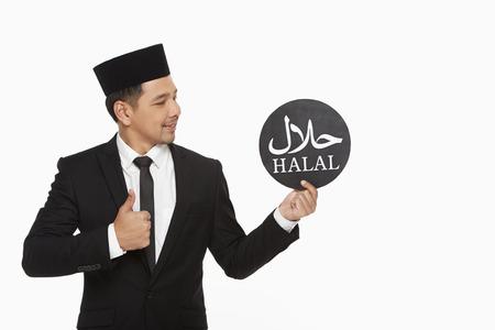 Businessman holding up a Halal sign